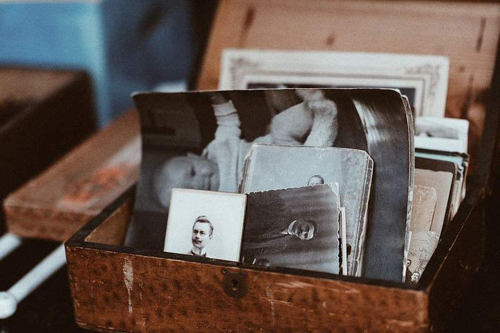 a wooden box with old photographs