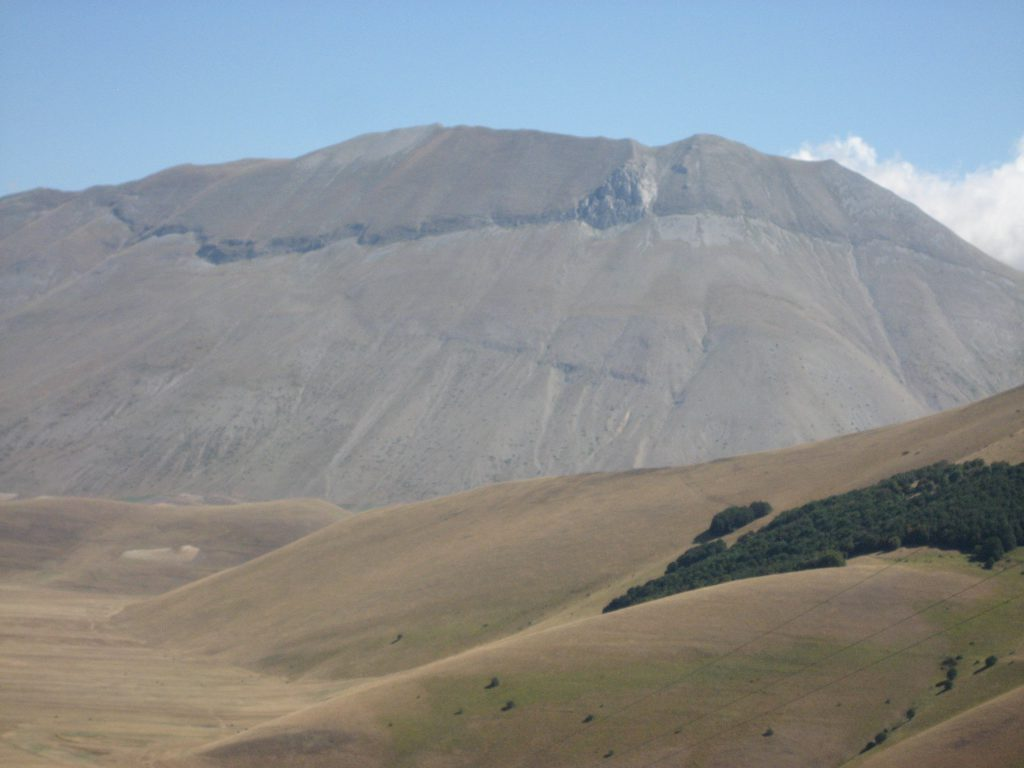 The high plateau of Castelluccio with the huge crack in the mountain chain