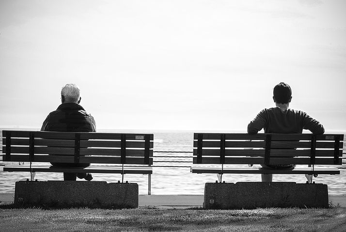 two people on two nearby benches