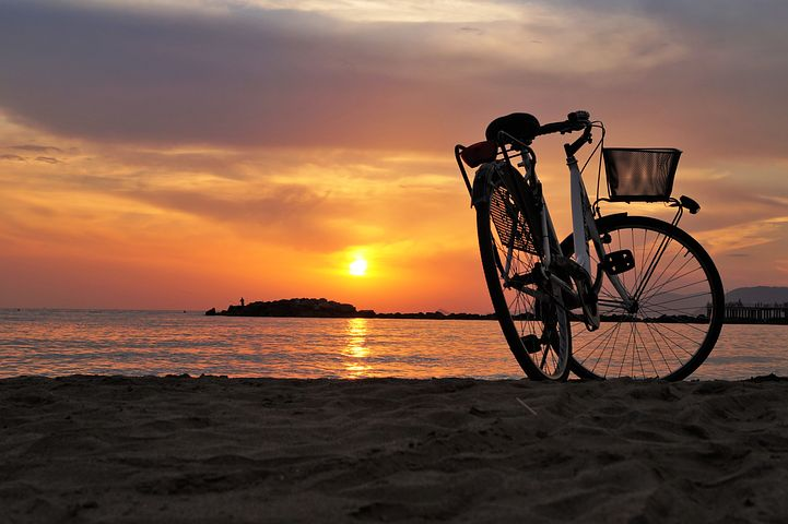 bike and sunset over water